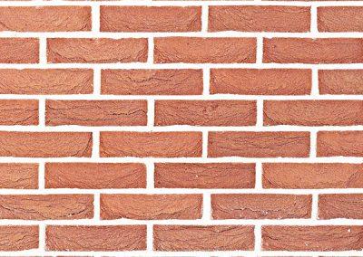 Baksteenstrip betonmuren